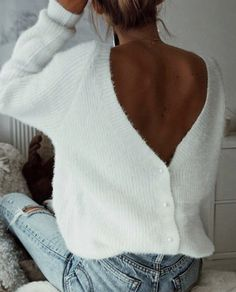 low back sweater. might even be a cardigan flipped backwards