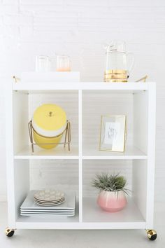 White-and-Gold Bar Cart. Repurpose existing black cube, store in pantry for parties