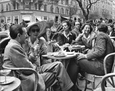 Count Sarmi, Baroness de Reutern, Princess Caracciolo-Ginnetti and Contessa Angelini-Rota dining outdoors at Cafe Doney. Photograph by Alfred Eisenstaedt.