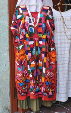 This very colorful red huipil was made in the Chinantec community of Valle Nacional in the north of Oaxaca, Mexico
