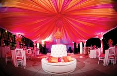 Neon pink and orange liners complement similar hued cushion covers and floral decor at this event by Social Butterflies LLC. Home Wedding Decorations, Reception Decorations, Event Decor, Reception Ideas, Wedding Reception, Orange And Pink Wedding, Red Wedding, Wedding House, Ceiling Decor
