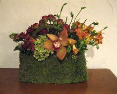 An autumnal palette makes this moss purse a great gift for a Thanksgiving hostess.