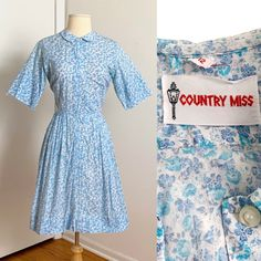"""1950s #CountryMiss floral print cotton #shirtdress in Etsy! B38"""" w26"""". Missing belt and needs a little tlc. 💙 Underarm Stains, Cotton Shirt Dress, Shirtdress, White Cotton, Printed Cotton, 1950s, Ready To Wear, Size 12, Floral Prints"""