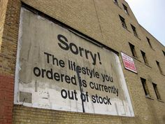 """Street art by Banksy, Blackwall Tunnel Approach, in Poplar, London. """"Sorry, the lifestyle you ordered is currently out of stock."""""""