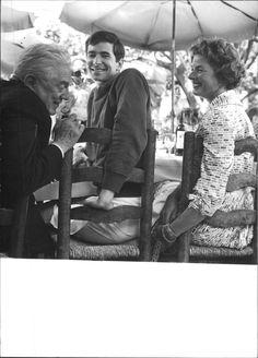 Vintage photo of Anthony Perkins and Ingrid Bergman sitting with man. -