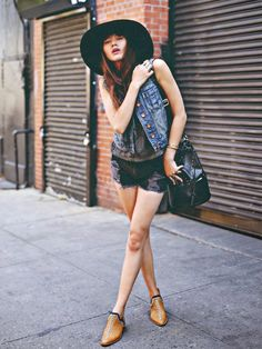 Natalie Suarez of Natalie Off Duty mixed utterly cool denim and leather pieces for a chic city look // #StreetStyle