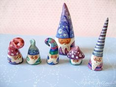 Mini gnomes sculpted from clay and hand painted - not a DIY but think in terms of salt clay and some paint.