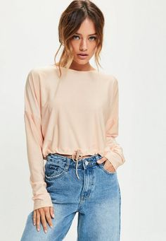 look pretty in pink and amp up your day game wearing this crop top - featuring a gathered hem, long sleeves and rounded neckline
