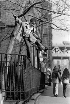 Walking the Tightrope High Above Henry Street- 1974, Neal Boenzi