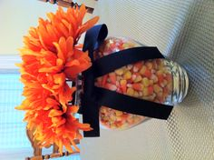 Halloween Centerpiece You can change out the candy, ribbon and flowers for every holiday or whenever. All you need is a vase to start with. You can use jelly beans for Easter, candy hearts for Valentine's day, red hots for Christmas, etc. I got this idea from my mom and I love it!!!