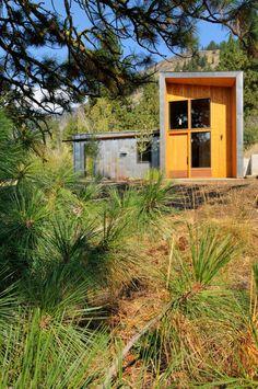 Entry and landscaping. Miner's Refuge, by Johnston Architects. Mazama, Washington.