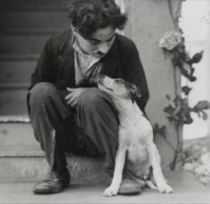 Charles Chaplin and a dog.
