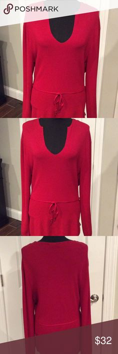 BCBG MAXAZRIA Red Sweater Great look and great quality at a great price!  This Red sweater from BCBG is the perfect addition to your wardrobe. Looks great with skirts, pants and even jeans!  Don't miss out on this one. This is 30 inches long. And comes with a tie belt!  Just BEAUTIFUL.  🌸 BCBGMaxAzria Sweaters V-Necks