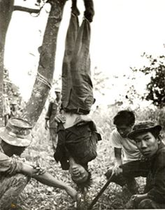 This was Sean Flynn's most famous war photo. A U.S. Special Forces team strung up and tortured a Viet Cong who had shot a little girl—1966.