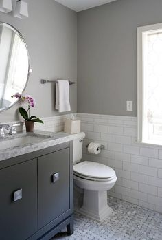Superbe Charming White And Gray Bathroom Features Floors Clad In Marble Basketweave  Tiles Complementing Large White Subway