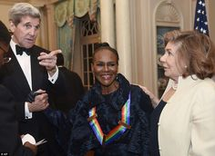 Who's over there? Kerry seems to be making a point while chatting to Kennedy Center Honoree Cicely Tyson and wife Teresa Heinz-Kerry following the State Department Dinner for the Honorees -Tyson, who has been nominated for 12 Emmy Awards, winning three, is also a celebrated star on stage - at 90, she currently is on Broadway with James Earl Jones in The Gin Game (fun fact, Jones voiced Lucas' Darth Vader in Star Wars)