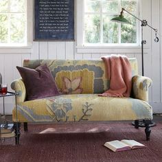 Not this, but something similar for downstairs, with metal legs?  PASSION FLOWER KILIM LOVESEAT