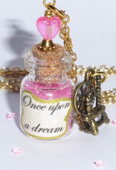 Sleeping Beauty Once upon a Dream Bottle Pendant Necklace with Spinning Wheel Charm from Etsy