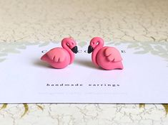 Unique handcrafted polymer clay earrings made with love, care and patience! These hot pink flamingos are crafted by hand then cured to form cute stud earrings. Match them with a flamingo shirt or dress to form a cute outfit. Earring backs are made from hypoallergenic surgical