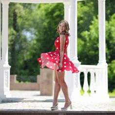 Portrait of a beautiful young girl in a red dress