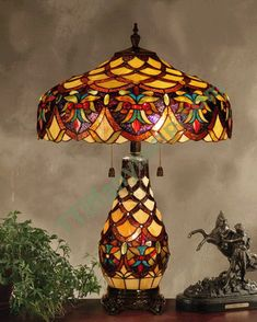 I kind of have a lamp fetish! Tiffany lamps are sooo.I kind of have a lamp fetish! Tiffany lamps are sooo lovely! Stained Glass Lamp Shades, Stained Glass Table Lamps, Stained Glass Light, Tiffany Stained Glass, Tiffany Glass, Louis Comfort Tiffany, Victorian Lamps, Antique Lamps, Vintage Lamps