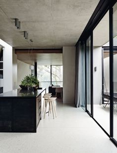 Ugh I cannot get enough of this combination-concrete, wood and black rimmed windows. The concrete keeps the room looking minimal, however the woods adds the warmth and coziness. It all balances out. The use of black within the room creates a uniform serious look but again it's balances by the wooden ceiling which softens this.