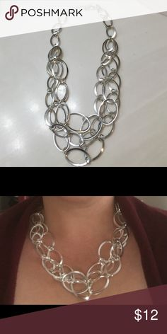 Silver fashion necklace Never been worn. Excellent condition and I love it but my boyfriend got me a Tiffany that I'm not allowed to take off lol. Daisy Fuentes Jewelry Necklaces