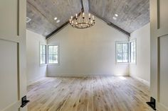 817 Friar Tuck Ln. Another living space that could be a study, media room or man cave with vaulted and aged shiplap ceiling. Designer fixtures throughout. Bernstein Realty, Houston Real Estate