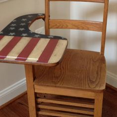 My patriotic renovation of an old desk from Mary Washington school of chemistry. I distressed the paint but didn't sand out all of the carved messages that were left by students.