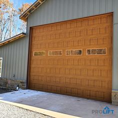 This extra large garage door is perfect for anyone needing a large entryway into a shop or garage. (18' x 14'). It's stylish, it's practical (windows, Honey Oak finish, low maintenance materials and triple insulation). | ProLift Garage Doors on Houzz | Project and Photo Credits: ProLift Garage Doors of Chattanooga
