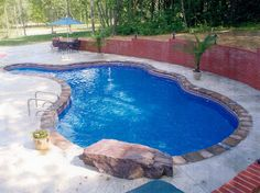Awesome Inground Swimming Pools with Magnificent Design: Inspiring Inground Swimming Pool Design In Traditional Pool With Several Curvy Side...