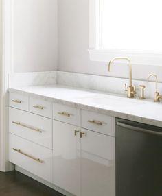 modern, sleek cabinetry sink. antique wood island