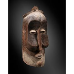 A SUKU HELMET MASK, DRC kakuungu, whose power is served by both the monumental dimension and the characteristic deformation of facial features... 90 cm