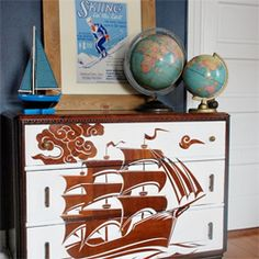 Took a vintage dresser that needed some sprucing up and used a reverse stencil technique to make ship for my son's big boy bedroom