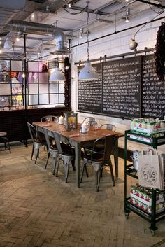 restaurant interior Almost looks like an old school room blackboards and wooden tables. Decoration Restaurant, Deco Restaurant, Restaurant Interior Design, Restaurant Counter, Wooden Table Restaurant, Industrial Restaurant Design, Old School Restaurant, Farmhouse Restaurant, Restaurant Tables And Chairs
