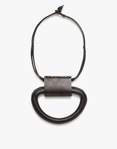 From Los Angeles-based Bandelier, a large hand stitched leather pendant on a short leather cord.   • Large leather necklace • Short leather cord • Sits just under collar • Inspired by traditional craft and culture • Handmade in Los Angeles