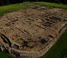 Vindolanda - Vindolanda was a Roman auxiliary fort (castrum) just south of Hadrian's Wall in northern England. Located near the modern village of Bardon Mill, it guarded the Stanegate, the Roman road from the River Tyne to the Solway Firth.