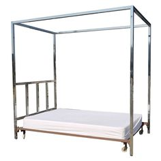 """Absolutely Stunning 1940s Chrome Canopy Bed    USA!  1940s  This is one of the nicest chrome beds I have ever seen. Very Billy Haines 1940's Chic. The headboard itself is seamless chrome and measures 54"""" by 84"""" by 2"""", and would cost a fortune to have custom chromed. The bed takes a double but could possibly take a queen since the bed doesnt have side rails. Would fit in well with Milo Baughman type pieces as well.    1st dibs @ Lewis -Trimble Decorative Arts and Antiques Kilmamoch, Va"""