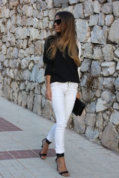 Black top with white sleeve, white skinny jeans, black scrappy heels. black clutch. Date night. Stitch Fix 2016