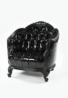 A patent leather tufted arm chair adds a touch of goth glam.