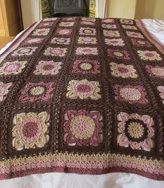 Brilliant granny blanket.  This would be spectacular in oatmeal and sage.  Hmmmm.  Link to the pattern from the original blog.