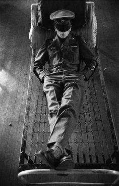 Photo by Harold Feinstein -  Napping in the barracks. Korea, 1952.