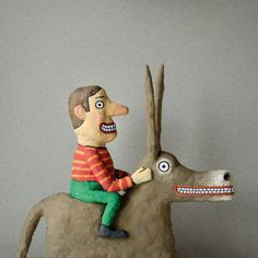 Burro and rider, both with wild, crazy eyes. Papier Mache.