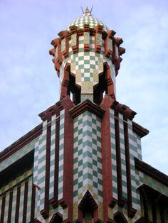 """Casa Vicens is a palace-like family residence in Barcelona, Spain, designed by Antoni Gaudí & built for industrialist Manuel Vicens between 1883-1889. It was Gaudí's first major work & was added in 2005 to the UNESCO World Heritage Site """"Works of Antoni Gaudí"""". The rooftop towers reflect a Moorish (Mudéjar) influence. The building is constructed of undressed stone, rough red bricks, & colored ceramic tiles in checkerboard & floral patterns. It is asymmetrical with protruding gables…"""