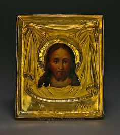 An antique Russian miniature travelling double icon with gold oklad (riza). The front is painted with The Holy Mandylion or Holy Face (also known as Not Made By Hands, Russian: Спас Нерукотворный),     the reverse -  with St. Nicholas.    1 7/8 x 2 3/16 in. (4,8 x 5,7 cm)    The chased two-tone gold oklad was made in Moscow in 1814.