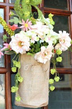 Spring flowers in burlap bags for the front door