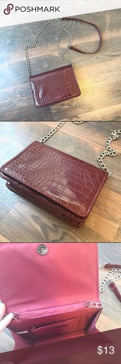 """Burgundy Chain Crossbody Super cute burgundy colored faux croc crossbody bag. The chain strap gives it an approximately 27"""" drop.   The bag itself is approximately 7.5"""" x 5"""" and has a magnetic clasp closure. It's in great shape. Bundle to save even more!! Bags Crossbody Bags"""