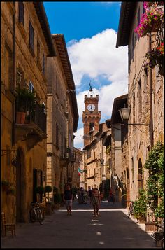 Main street of the (architecturally speaking) most important village in the Orcia valley, Pienza, with the tower of the Public Palace