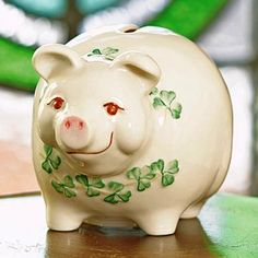 This adorable Belleek piggy bank is an Irish collectible made for saving. Drop your pennies and a dream into this charming piggy bank. The friendly irish piggy bank is handpainted with green shamrocks and pink blush snout. A wonderful collectable for wee Irish Pottery, Belleek China, Belleek Pottery, Pig Bank, Penny Bank, Irish Culture, Irish Jewelry, This Little Piggy, Irish Traditions