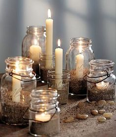 MASON JARS :: Mason jar vignette w/ candles in sand...lovely.  Maybe on silver/mirrored tray for extra sparkle? | #masonjars #candles